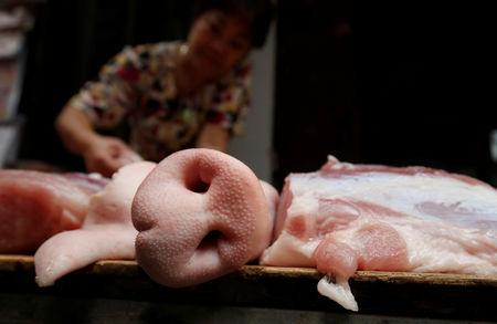 FILE PHOTO: Pork is displayed for sale at a market in Hanoi