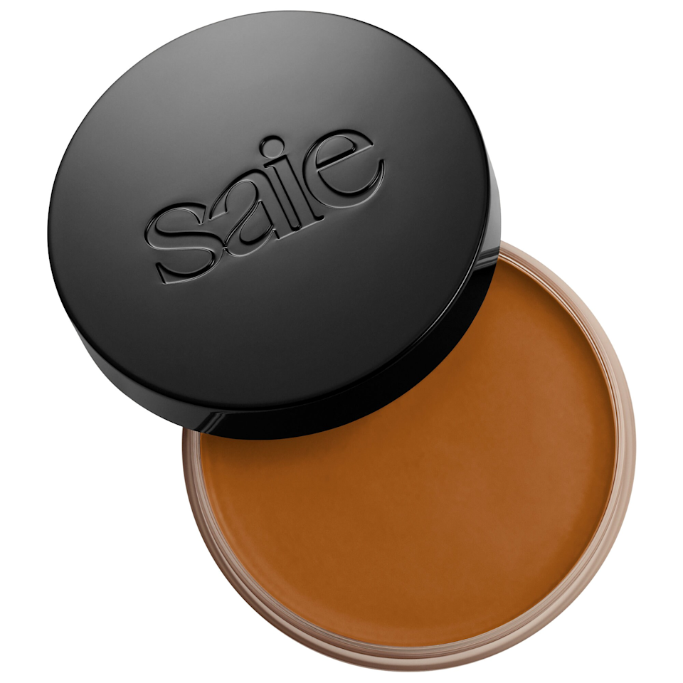"""This yummy bronzer has a balmy texture, making it perfect for skin types on the dryer side. The formula even has skin care ingredients like colloidal oatmeal and grapeseed oil to soothe and moisturize skin. Even if you don't need the extra moisture, you'll appreciate the dewy-but-not-shiny finish, and easy to blend texture. $28, Sephora. <a href=""""https://shop-links.co/1743418737696645924"""" rel=""""nofollow noopener"""" target=""""_blank"""" data-ylk=""""slk:Get it now!"""" class=""""link rapid-noclick-resp"""">Get it now!</a>"""