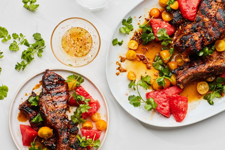 "In this grilled pork recipe from chef Paul Kahan, you'll marinate juicy country-style ribs in brown sugar, soy sauce, rice vinegar, garlic, ginger, and toasted sesame oil over night, then grill until nicely charred, then dunk them in a boiled portion of the marinade to get them extra saucy before the final bit of cooking. Watermelon gets a quick-pickle to make this meal refreshing and bright. <a href=""https://www.epicurious.com/recipes/food/views/country-style-ribs-with-quick-pickled-watermelon?mbid=synd_yahoo_rss"" rel=""nofollow noopener"" target=""_blank"" data-ylk=""slk:See recipe."" class=""link rapid-noclick-resp"">See recipe.</a>"