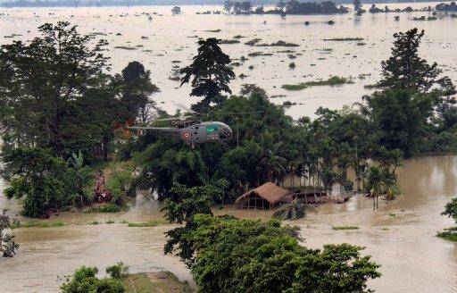 Monsoon floods in the northeast of India have killed scores of people but rainfall has been weak in some other regions
