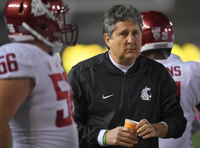 "Mike Leach is apparently doubling down on defending his tweeting of a fake Barack Obama conspiracy video on Tuesday, and challenged USA Today columnist to a ""debate."" (Getty Images)"