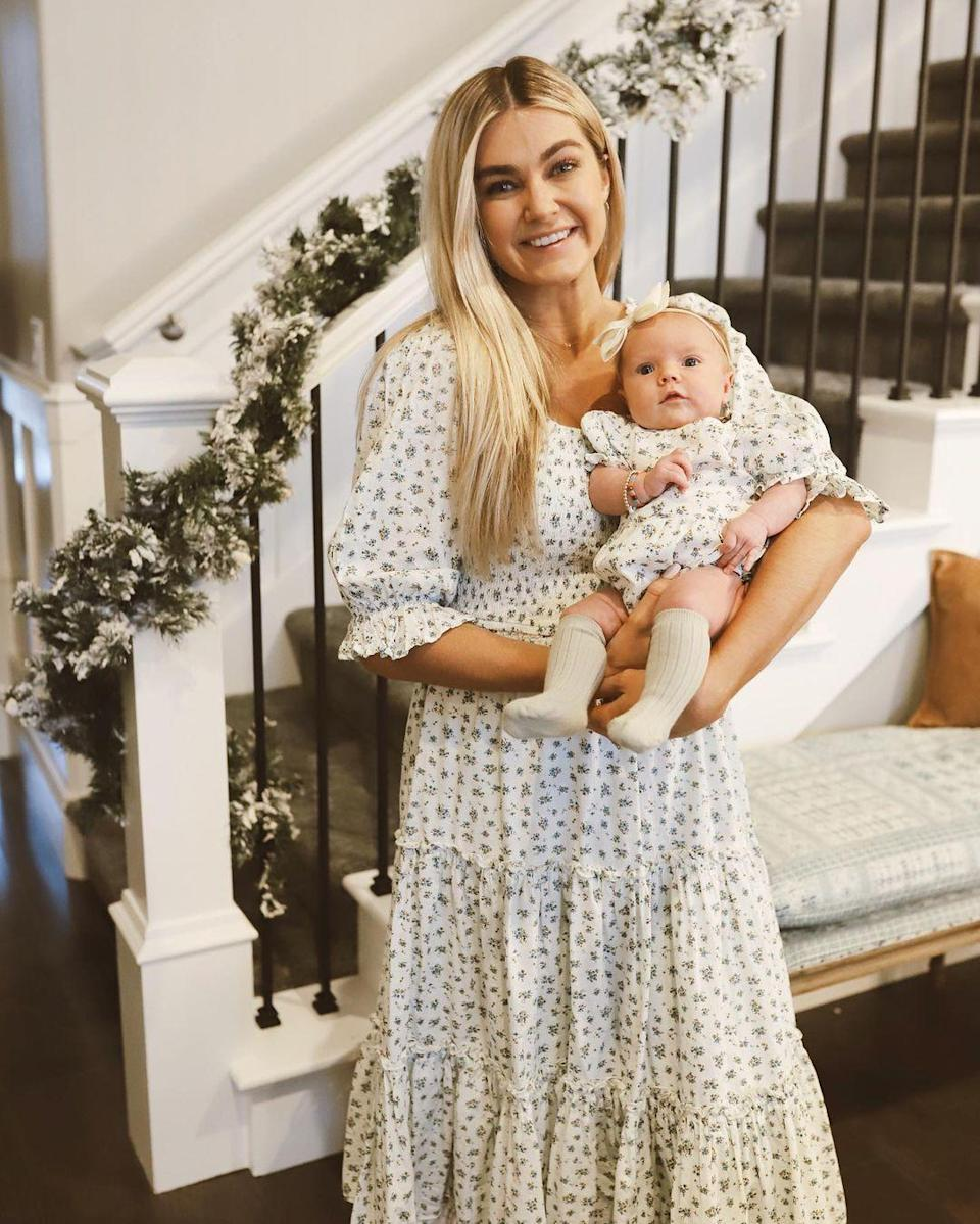 "<p>Arnold was back at it again with the matching outfits, only this time mom and baby wore floral ensembles! ""Wore this dress at my baby shower 6 weeks before I gave birth when Sagey was still in my tummy and now matching with baby girl 6 weeks after she came into our lives is a pretty special moment for me 😭,"" Arnold <a href=""https://www.instagram.com/p/CIzEy6oH88R/"" rel=""nofollow noopener"" target=""_blank"" data-ylk=""slk:shared"" class=""link rapid-noclick-resp"">shared</a>. </p>"