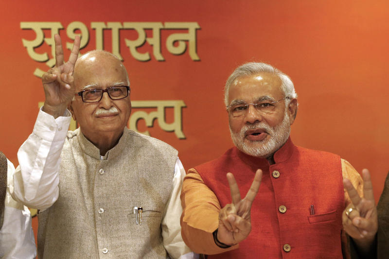 Narendra Modi, right, leader of India's main opposition Bharatiya Janata Party (BJP) and its prime ministerial candidate for next year's national elections, flashes a victory sign, along with senior leader Lal Krishna Advani at the party's office in New Delhi, India, Sunday, Dec. 8, 2013. BJP, the main Hindu nationalist party, appeared to make strong political gains in four heartland states Sunday, as preliminary results showed the ruling Congress party sidelined in a race seen as a test before next year's general election. (AP Photo/Saurabh Das)