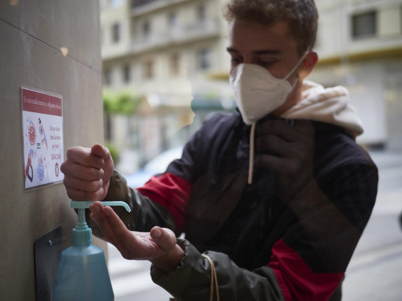 PAMPLONA, SPAIN - MAY 11: A man disinfects his hands before entering Urban Sons fashion store to protect from Covid-19 on the day all the region of Navarra passes to Phase 1 of the reduction of confinement established by the Government of Spain on May 11, 2020 in Pamplona, Spain. In the event a customer tries on a garment that they subsequently do not purchase, it must be sanitized, as well as any return of garments made by customers. (Photo by Eduardo Sanz/Europa Press via Getty Images)