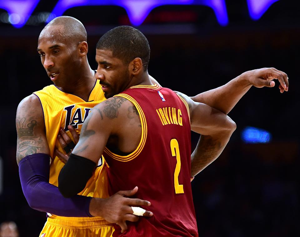 LOS ANGELES, CA - MARCH 10:  Kobe Bryant #24 of the Los Angeles Lakers gueards Kyrie Irving #2 of the Cleveland Cavaliers during a 120-108 Cavaliers win at Staples Center on March 10, 2016 in Los Angeles, California.  NOTE TO USER: User expressly acknowledges and agrees that, by downloading and or using this Photograph, user is consenting to the terms and condition of the Getty Images License Agreement.  (Photo by Harry How/Getty Images)