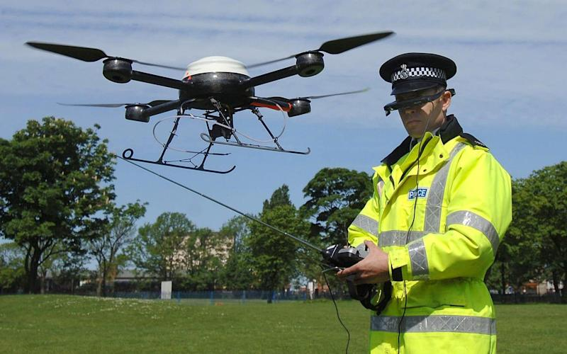 The police use drones for aerial surveillance but prisoners use them to smuggle drugs and mobile phones - PA