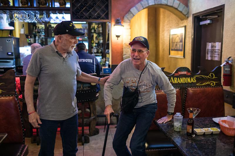 Richard Blakely helps Yarling stand up after dining together at a Mexican restaurant in Austin. (Tamir Kalifa for HuffPost)