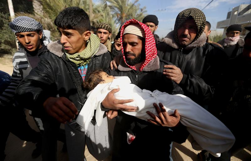Palestinians carry the body of 3-year-old Hala Abu Sebakha during her funeral in the Gaza Strip, Wednesday, Dec. 25, 2013. Israeli air and ground forces launched a series of attacks Tuesday on targets across the Gaza Strip, killing Hala and wounding several others in response to the deadly shooting of an Israeli civilian by a Palestinian sniper. (AP Photo/Hatem Moussa)