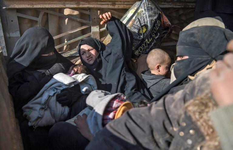 "The women and children fleeing what is left of the Islamic State group's ""caliphate"" face confinement in one or other of two camps set up for displaced civilians while their jihadist menfolk languish in prison"