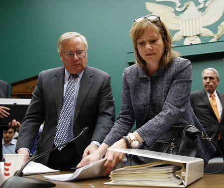 Michael Millikin GM's general counsel since 2009 and a key counselor to Chief Executive Mary Barra looks on as Barra gets ready to depart after testifying on Capitol Hill in Washington
