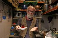 Experts say that Iranians consume an average of nine small glasses of tea a day, or 100,000 tonnes nationwide every year (AFP/ATTA KENARE)
