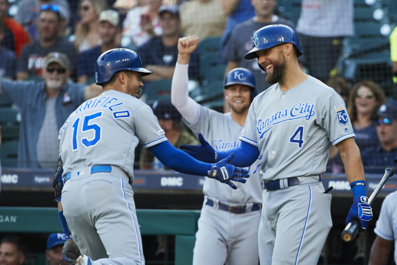Aug 9, 2019; Detroit, MI, USA; Kansas City Royals second baseman Whit Merrifield (15) celebrates with left fielder Alex Gordon (4) after hitting a home run in the first inning against the Detroit Tigers at Comerica Park. Mandatory Credit: Rick Osentoski-USA TODAY Sports