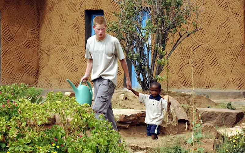 Prince Harry with orphan Mutsu Potsane in 2004  - PA