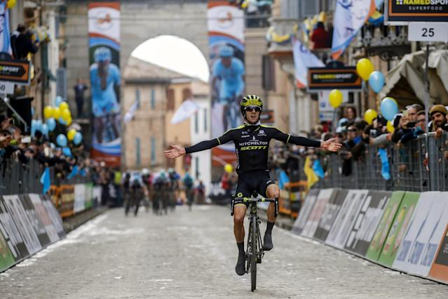 Britain's Adam Yates celebrates as he crosses the finish line to win the 5th stage of the Tirreno-Adriatico cycling race, from Castelraimondo to Filottrano, Italy, Sunday, March 11, 2018. (Dario Belingheri/ANSA via AP)