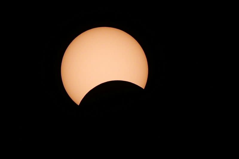 A photo shows a partial solar eclipse observed in Amman