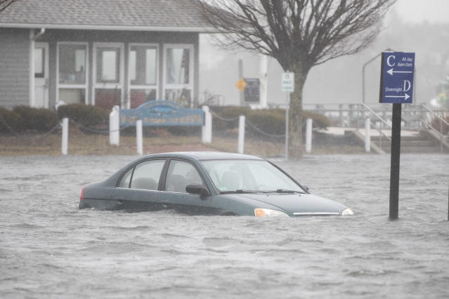 <p>A flooded car parked in a lot behind Front St. as a large coastal storm affects the area on March 2, 2018 in Scituate, Mass. (Photo: Scott Eisen/Getty Images) </p>