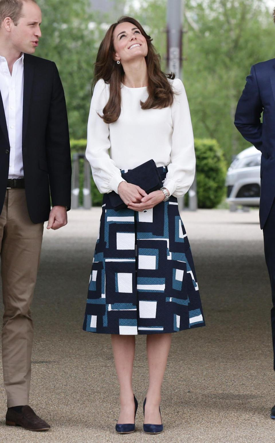 <p>Kate's visit to London's Olympic Park to launch a mental health campaign featured a printed calf-length skirt by Banana Republic along with a white silk blouse and Rupert Sanderson pumps.</p><p><i>[Photo: PA]</i></p>