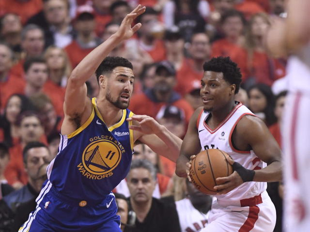 Toronto Raptors guard Kyle Lowry, right, handles the ball under pressure from Golden State Warriors guard Klay Thompson (11) during first-half basketball game action in Game 5 of the NBA Finals in Toronto, Monday, June 10, 2019. (Frank Gunn/The Canadian Press via AP)