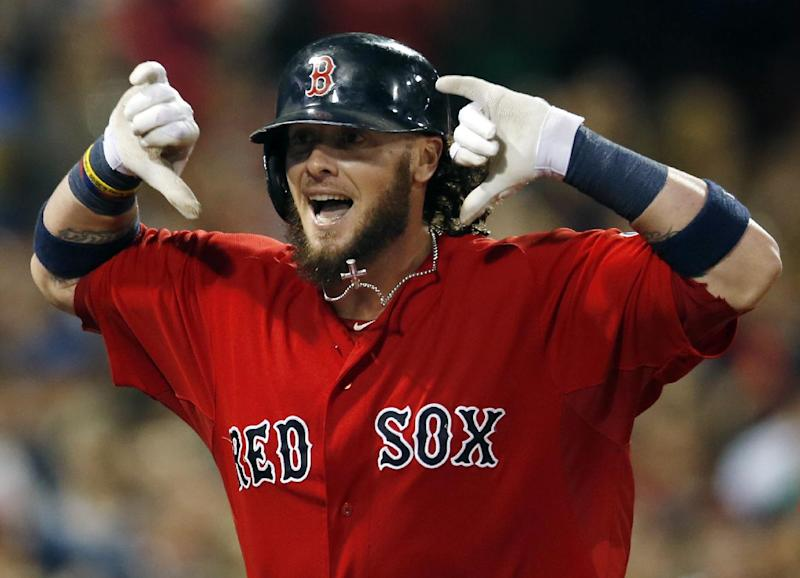 Boston Red Sox's Jarrod Saltalamacchia gestures as he runs toward the dugout after his grand slam in the seventh inning of a baseball game against the New York Yankees at Fenway Park in Boston on Friday, Sept. 13, 2013. (AP Photo/Elise Amendola)