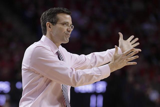 Nebraska coach Tim Miles gestures on the sidelines in the first half of an NCAA college basketball game against Penn State in Lincoln, Neb., Thursday, Feb. 20, 2014. (AP Photo/Nati Harnik)
