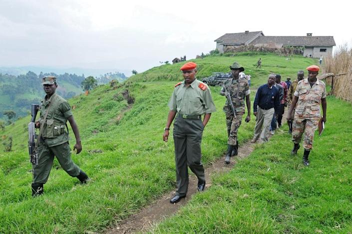Then rebel general Bosco Ntaganda (C) inspects his mountain base in Kabati, north west of the provincial capital Goma, Democratic Republic of Congo in 2009 (AFP Photo/Lionel Healing)