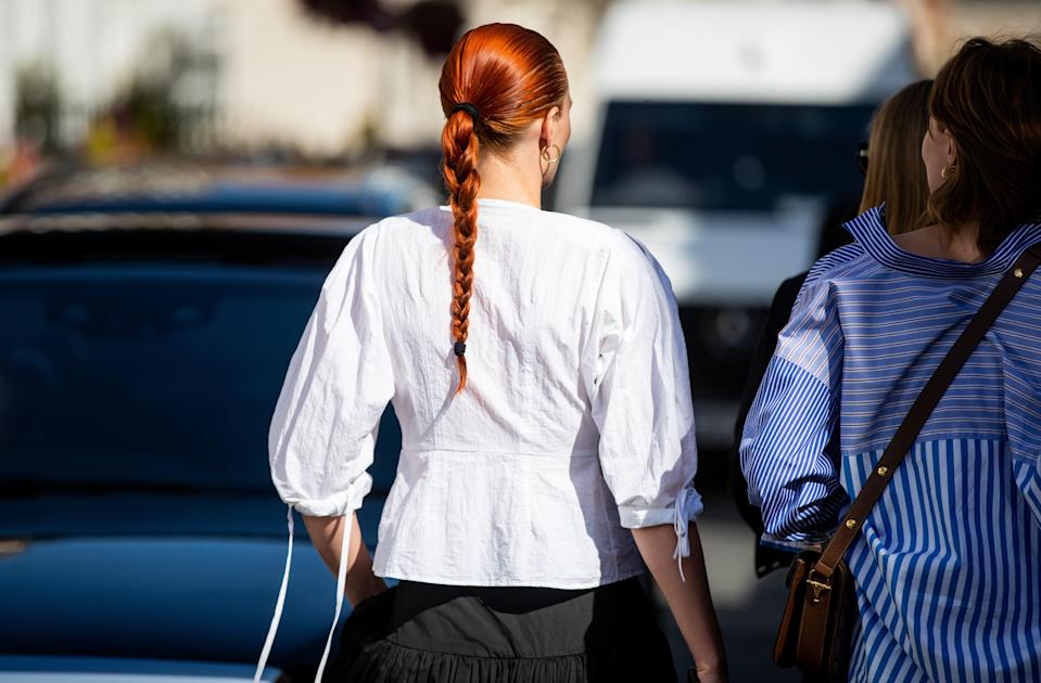 Looking for summer hairstyles for long hair? Slick your hair back into a tight, sleek braid to beat the heat.