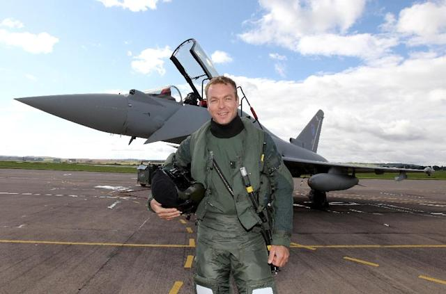 Since retiring from cycling Chris Hoy has driven at Le Mans, flown in a Typhoon jet and is now planning to ride to the South Pole. (AFP Photo/ANDREW MILLIGAN)