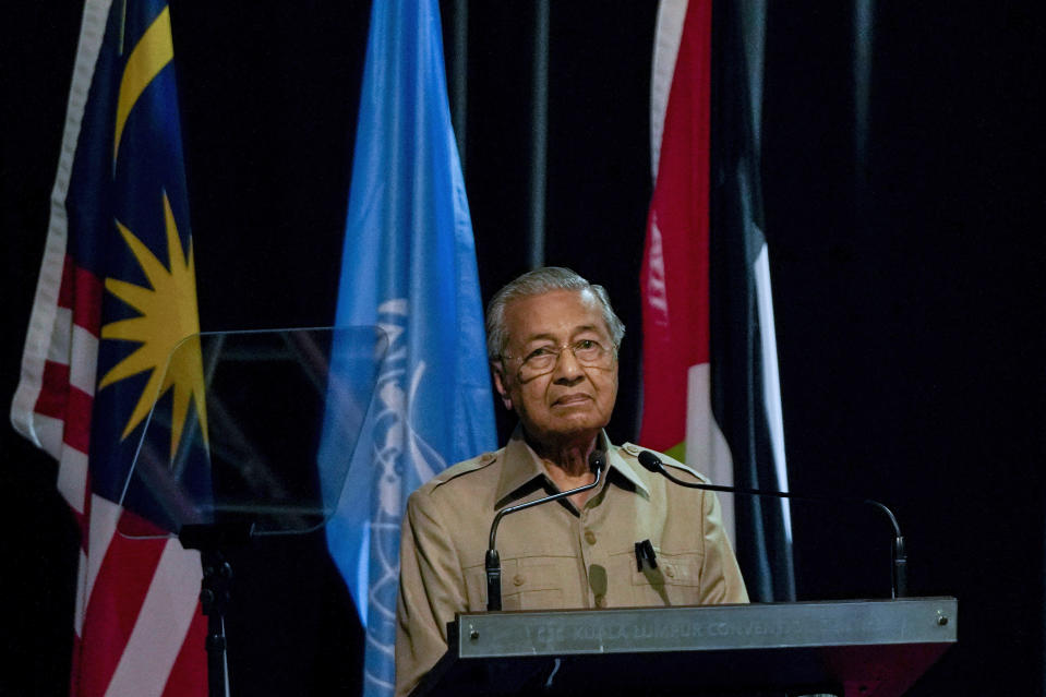 Malaysia's interim leader Mahathir Mohamad pauses during a speech at the committee on the exercise of the inalienable rights of the Palestinian people, in Kuala Lumpur, Malaysia, Friday, Feb. 28, 2020. The speaker of Malaysia's House rejected Mahathir Mohamad's call for a vote next week to chose a new premier, deepening the country's political turmoil after the ruling alliance collapsed this week. (AP Photo/Vincent Thian)