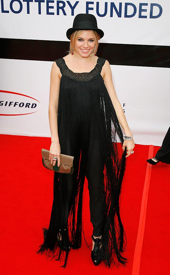 "Apparently Sienna Miller shares Mischa Barton's love of fringe. We, however, don't agree with that trend ... nor do we agree with that hat, that clutch, or those shoes. Eamonn McCormack/<a href=""http://www.gettyimages.com/"" target=""new"">GettyImages.com</a> - June 18, 2008"