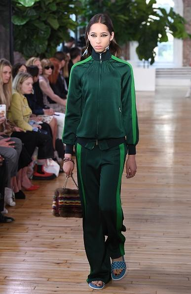 <p>A model in a green tracksuit walks the runway for the Valentino Resort 2018 runway show in New York City. (Photo: Getty Images) </p>