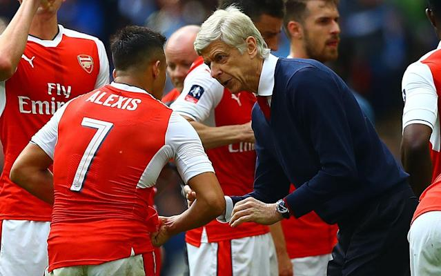 <span>Arsene Wenger instructs Alexis Sanchez</span> <span>Credit: Rex Features </span>