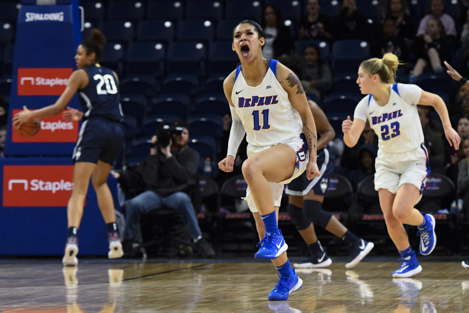 DePaul Blue Demons guard Sonya Morris (11) reacts after scoring against Connecticut during the second half of an NCAA college basketball game on Monday, Dec. 16, 2019. in Chicago, Ill. (AP Photo/Matt Marton)
