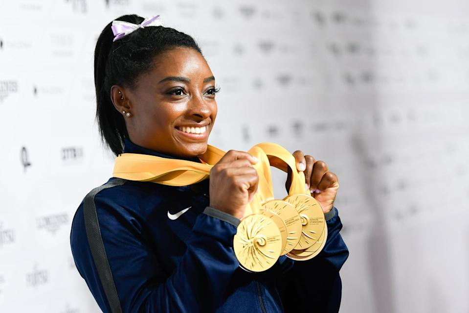 """<p><strong>Sport:</strong> Gymnastics<br> <strong>Country:</strong> USA</p> <p>Biles hardly needs an introduction at this point. The 23-year-old gymnast is making one last run at the Olympics and looking to cement her status as the <a href=""""https://www.popsugar.com/fitness/simone-biles-best-routines-all-time-47211985"""" class=""""link rapid-noclick-resp"""" rel=""""nofollow noopener"""" target=""""_blank"""" data-ylk=""""slk:greatest gymnast of all time"""">greatest gymnast of all time</a>, with <a href=""""https://www.popsugar.com/fitness/fascinating-facts-about-simone-biles-47259021"""" class=""""link rapid-noclick-resp"""" rel=""""nofollow noopener"""" target=""""_blank"""" data-ylk=""""slk:five Olympic and 25 World Championship medals"""">five Olympic and 25 World Championship medals</a> already under her belt. Her tricks get more stunning every year (she has <a href=""""https://www.popsugar.com/fitness/Gymnastics-Moves-Named-After-Simone-Biles-46488523"""" class=""""link rapid-noclick-resp"""" rel=""""nofollow noopener"""" target=""""_blank"""" data-ylk=""""slk:three named after her"""">three named after her</a>, which means she was the first to pull them in competition), and their level of difficulty and the ease with which she executes them put her miles above the rest of the competition; she can fall during routines <a href=""""https://www.popsugar.com/fitness/how-simone-biles-can-score-so-high-in-gymnastics-46593840"""" class=""""link rapid-noclick-resp"""" rel=""""nofollow noopener"""" target=""""_blank"""" data-ylk=""""slk:and still earn the highest score"""">and still earn the highest score</a>. One of the most recognizable and decorated athletes at the Games, we'll be tuning in every time she's in the arena.</p>"""