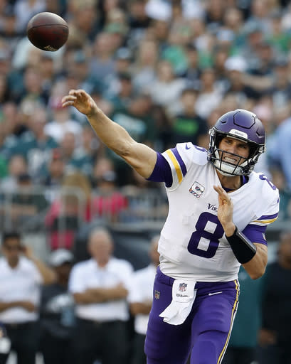 FILE - In this Oct. 7, 2018, file photo, Minnesota Vikings quarterback Kirk Cousins throws during an NFL football game against the Philadelphia Eagles, in Philadelphia. The Minnesota Vikings have become a prolific passing team under new quarterback Kirk Cousins. (Winslow Townson/File)