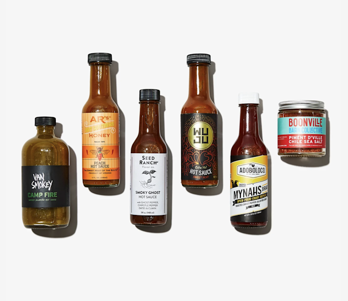 """When it comes to wings, some like it hot—and some like it extra hot. Either way, he's got options with Bespoke Post's """"Scorch"""" box, featuring an impressive lineup of craft sauces. $45, Bespoke Post. <a href=""""https://www.bespokepost.com/box/scorch"""" rel=""""nofollow noopener"""" target=""""_blank"""" data-ylk=""""slk:Get it now!"""" class=""""link rapid-noclick-resp"""">Get it now!</a>"""