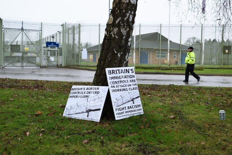 Protest placards outside immigration detention centre.