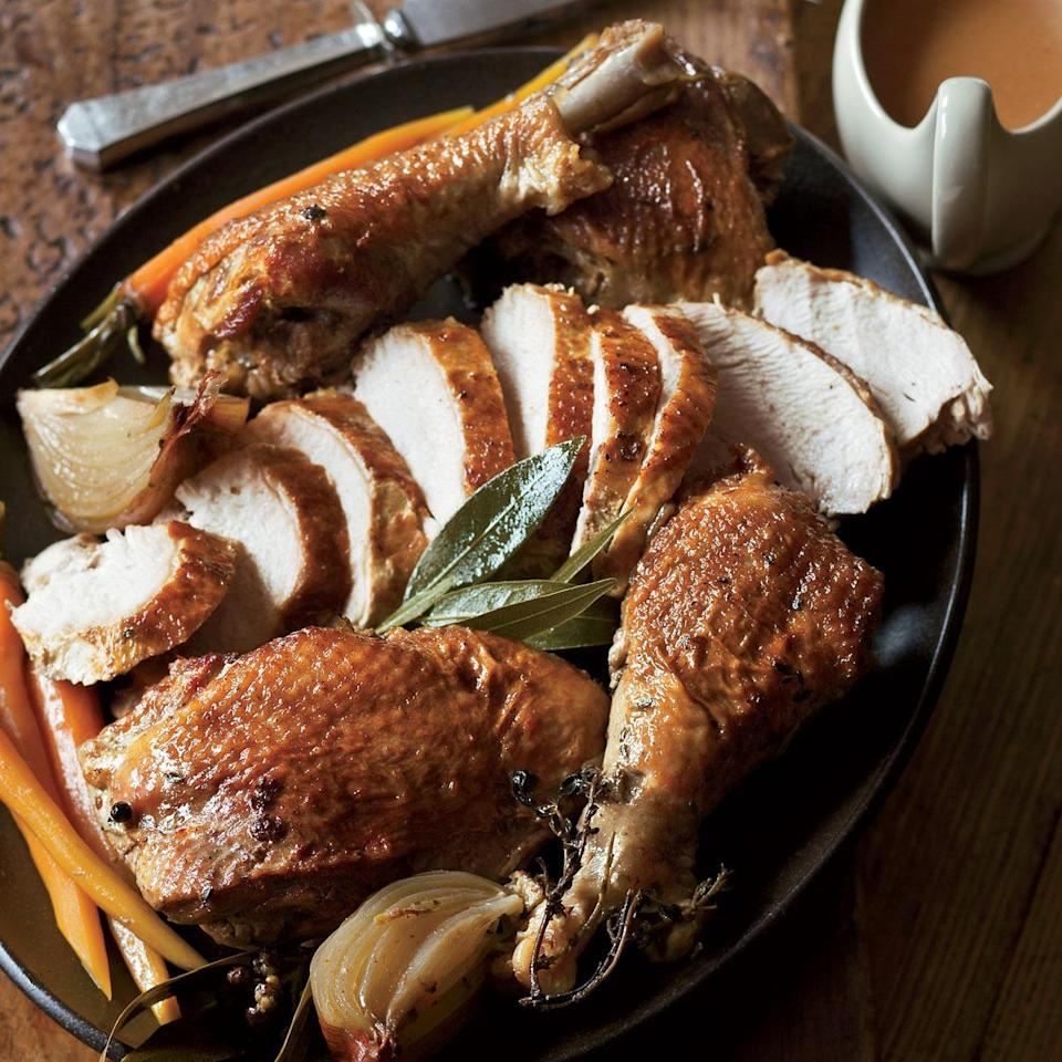 """<p>The cooking time is much less than a traditional recipe since the white and dark meats are cooked separately, which also helps keep the breast meat from drying out. Bonus: The legs can be braised up to two days ahead. <a href=""""http://www.foodandwine.com/recipes/herbed-turkey-two-ways"""" rel=""""nofollow noopener"""" target=""""_blank"""" data-ylk=""""slk:Get the recipe for Herbed Turkey Two Ways at Food & Wine."""" class=""""link rapid-noclick-resp""""><b>Get the recipe for Herbed Turkey Two Ways at Food & Wine</b>.</a> <i>Photo: Quentin Bacon/Food & Wine </i><br></p>"""