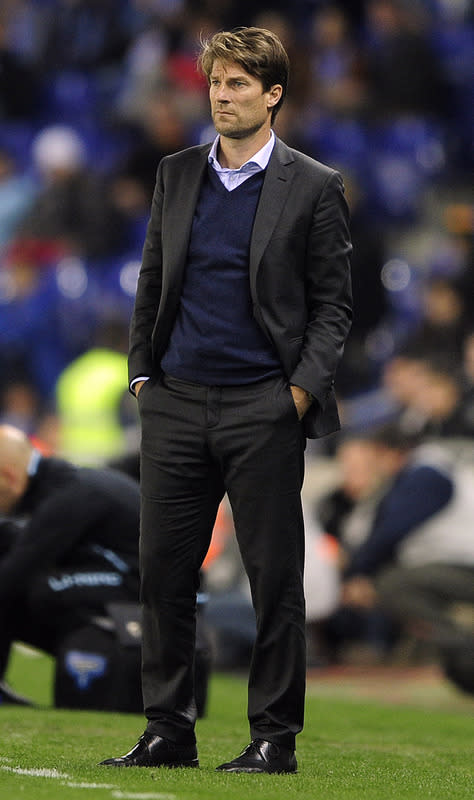 (FILES) In a file picture taken on March 1, 2011 Michael Laudrup, then Mallorca's coach, watches the action during the Spanish league football match RCD Espanyol against Mallorca at the Cornella-El Prat stadium in Cornella de Llobregat. Denmark legend Michael Laudrup was on June 15, 2012 named as Swansea's new manager, the Premier League club announced. AFP PHOTO / JOSEP LAGOJOSEP LAGO/AFP/GettyImages