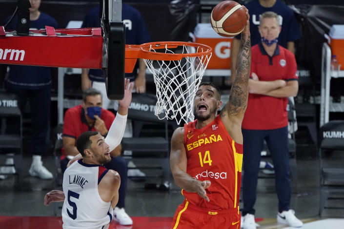 Spain's Willy Hernangomez (14) dunks against United States' Zachary Lavine (5) during the second half of an exhibition basketball game in preparation for the Olympics, Sunday, July 18, 2021, in Las Vegas. (AP Photo/John Locher)