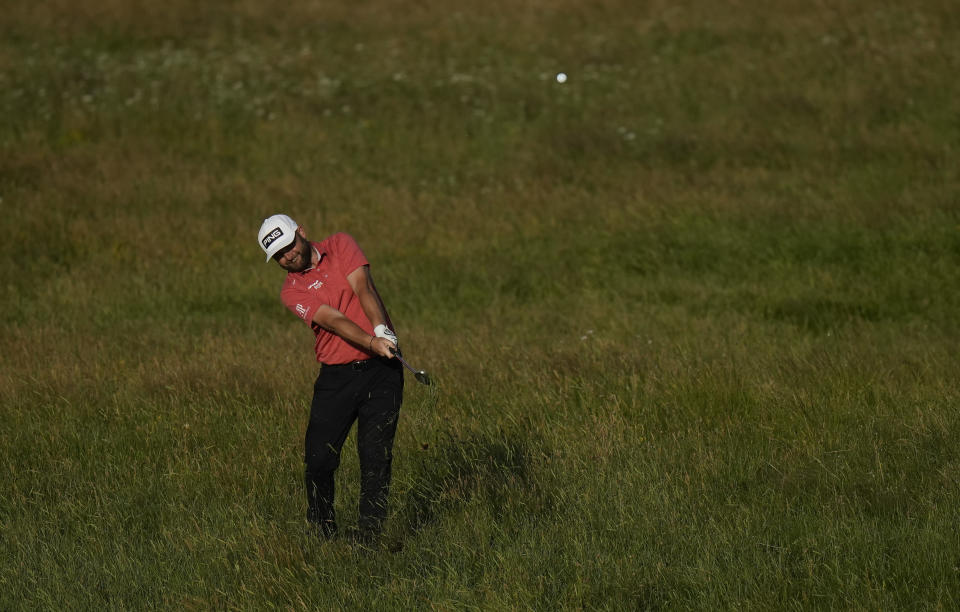 England's Andy Sullivan plays a shot from the rough on the 2nd hole during the first round British Open Golf Championship at Royal St George's golf course Sandwich, England, Thursday, July 15, 2021. (AP Photo/Alastair Grant)