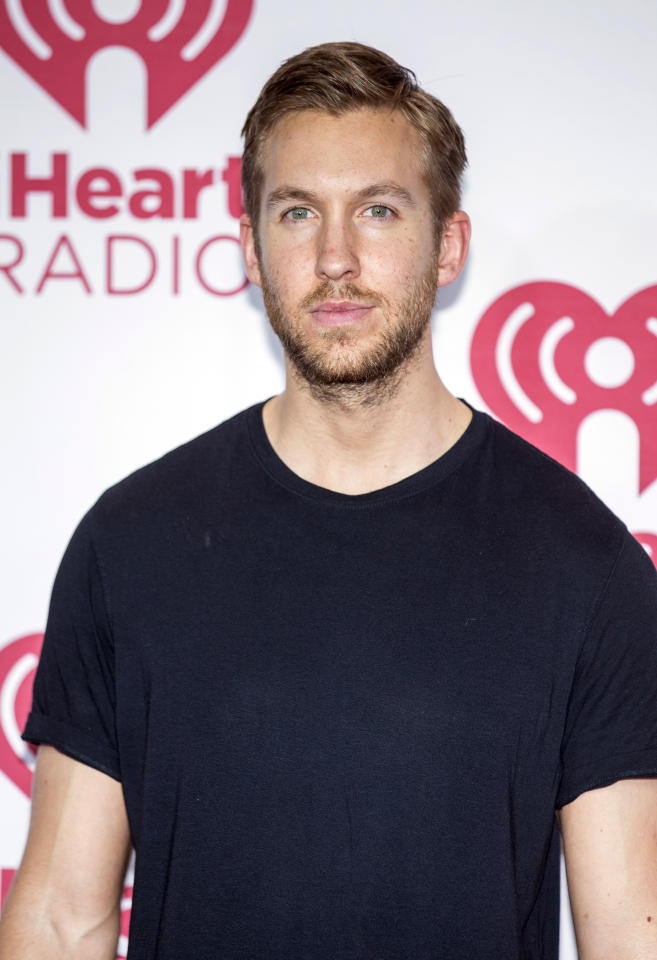 "File - In this Sept. 20, 2014, file photo, Calvin Harris arrives at the iHeart Radio Music Festival, at The MGM Grand Garden Arena in Las Vegas. Harris, who wrote and produced Rihanna's hit ""We Found Love,"" is set to perform at the singer's charity event Sept. 14, 2017. Rihanna said Wednesday, Aug. 16, 2017, that the Scottish DJ-producer will join fellow performer Kendrick Lamar and host Dave Chappelle for her third Diamond Ball. (Photo by Andrew Estey/Invision/AP, File)"