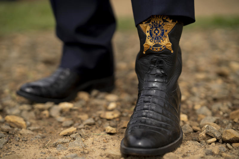Sheriff Larry Smith's boots. (Nitashia Johnson / for the Marshall Project and NBC News)