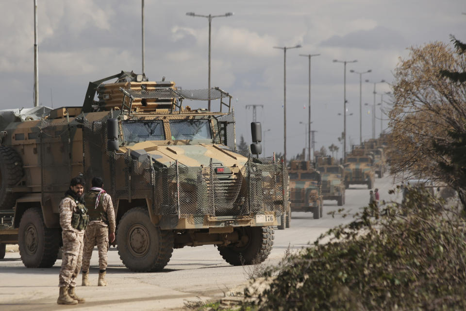 Turkish military convoy drives in Idlib province, Syria, Saturday, Feb. 22, 2020. A Turkish soldier was killed in Syria's northwest Idlib province, state-run Anadolu news agency reported Saturday. (AP Photo/Ghaith Alsayed)