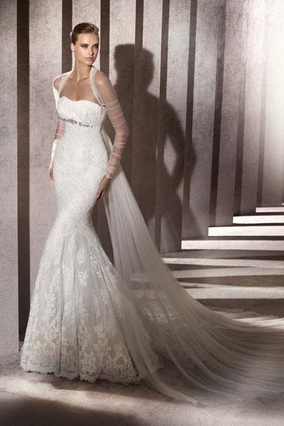 """<div class=""""caption-credit""""> Photo by: Pronovias</div><div class=""""caption-title"""">15. Pronovias</div>We love this sexy lace mermaid by Pronovias. The sleeves and watteau train add sheer drama. <br> <br> Check out more gorgeous styles in our <a rel=""""nofollow noopener"""" href=""""http://www.bridalguide.com/photo-galleries/bridal-gowns/pronovias/style-baile"""" target=""""_blank"""" data-ylk=""""slk:Pronovias gown gallery"""" class=""""link rapid-noclick-resp"""">Pronovias gown gallery</a>!"""