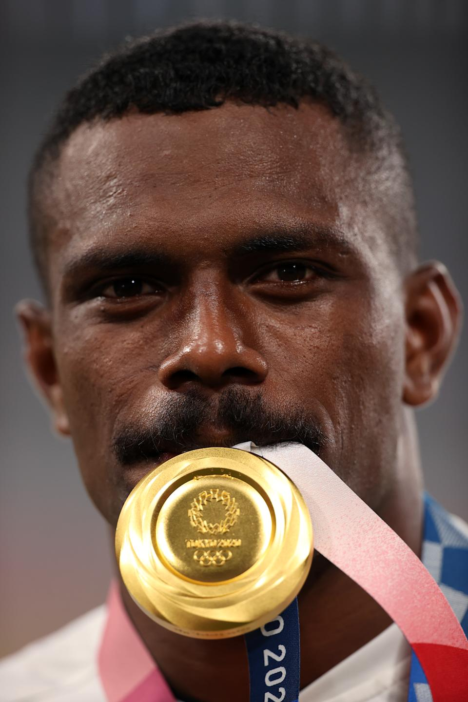 <p>CHOFU, JAPAN - JULY 28: Jiuta Wainiqolo of Team Fiji poses with his gold medal following victory in the Rugby Sevens Men's Gold Medal match between New Zealand and Fiji on day five of the Tokyo 2020 Olympic Games at Tokyo Stadium on July 28, 2021 in Chofu, Tokyo, Japan. (Photo by Dan Mullan/Getty Images)</p>