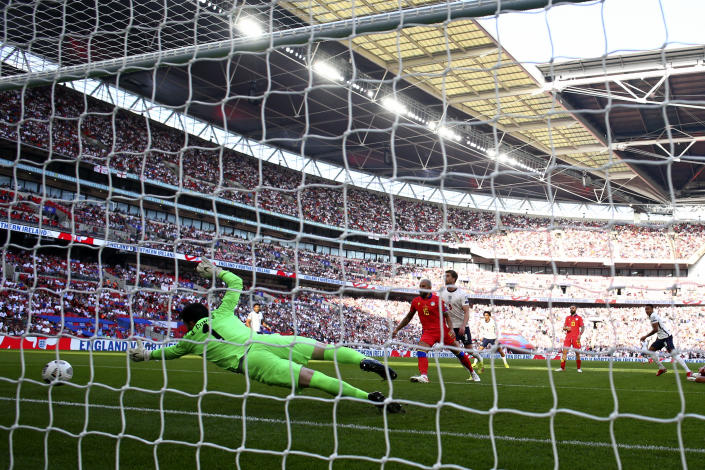 England's Jesse Lingard, right, scores the opening goal during the World Cup 2022 group I qualifying soccer match between England and Andorra at Wembley stadium in London, Sunday, Sept. 5, 2021. (AP Photo/Ian Walton)