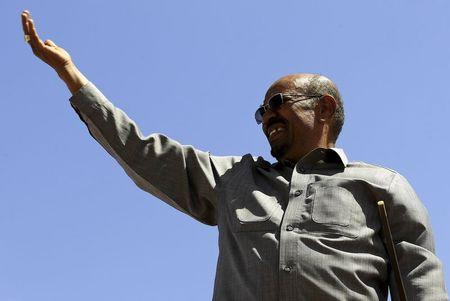 Sudan's President Omar Hassan al-Bashir waves to supporters during a campaign rally at Al Fashir in North Darfur
