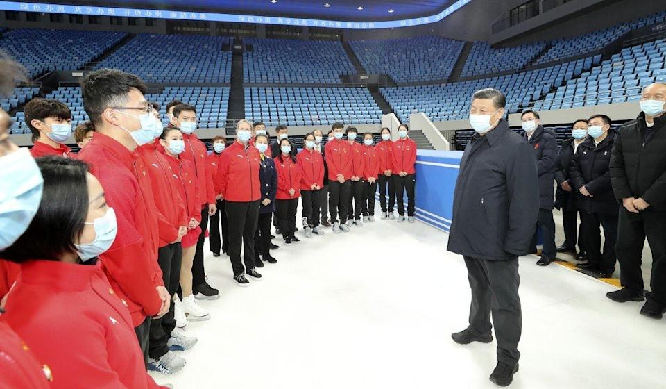 Chinese President Xi Jinping speaks with athletes and coaches during a tour of venues for the 2022 Olympics at the Capital Gymnasium in Beijing on January 18. Photo: Xinhua via AP