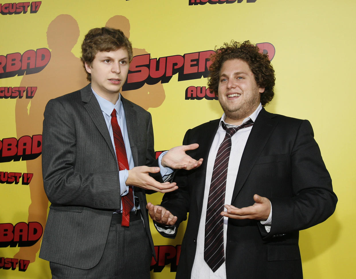 Cast members Michael Cera (L) and Jonah Hill pose at the premiere of