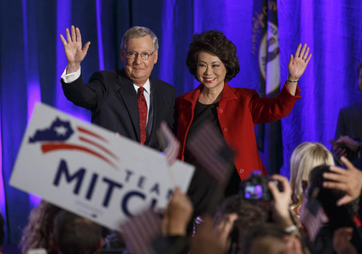 Then-Senate Minority Leader Mitch McConnell, R-Ky., joined by his wife, former Labor Secretary Elaine Chao, celebrates with his supporters at an election night party in Louisville, Ky., Tuesday, Nov. 4, 2014. (Photo: J. Scott Applewhite/AP)